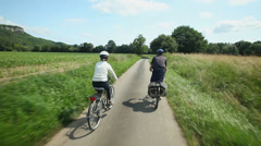 Retired couple cycling Stock Footage