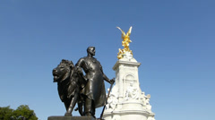 The Victoria Memorial, Buckingham Palace, London. UK. Blue sky background. Stock Footage