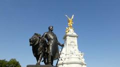 The Victoria Memorial, Buckingham Palace, London. UK. Blue sky background. Stock Footage