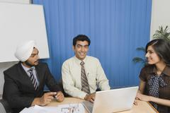 Business executives having a meeting in an office Stock Photos