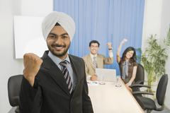 Business executives showing fist and smiling Stock Photos