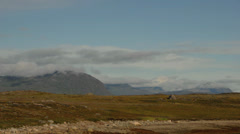 Wide time-lapse of clouds over a rocky landscape in Greenland - stock footage