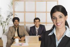 Stock Photo of Portrait of a businesswoman with her colleagues in the background