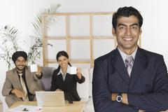 Stock Photo of Portrait of a businessman with his colleagues in the background