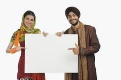Portrait of a Sikh couple holding a blank placard Stock Photos