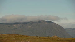 Timelapse clouds over a rocky outcrop in Greenland Stock Footage