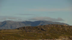 Timelapse clouds over a rocky landscape in Greenland Stock Footage