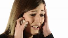 Brunette girl quarreling on the telephone Stock Footage