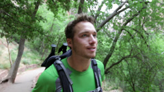 Hiking man - hiker trekking with backpack - stock footage