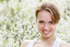 Smiling young blond woman Stock Photos