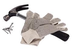 Pair of work glove with claw hammer and nails Stock Photos