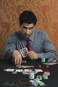 Portrait of a man gambling in a casino - stock photo