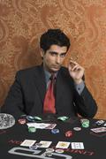 Portrait of a man gambling - stock photo
