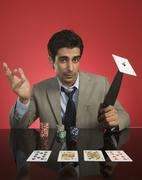 Stock Photo of Portrait of a man gambling in a casino