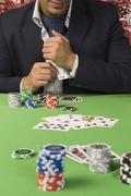 Man at a casino table - stock photo