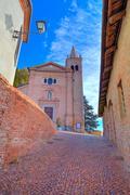 Old church and narrow street. monticello d'alba, italy. Stock Photos