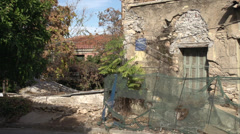 Stock Video Footage of rundown home, handheld medium shot