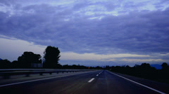 Traveling along road at down just before sunrise timelapse - stock video Stock Footage