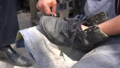 Shoe repair, large boot, in Uzbek bazaar Stock Footage