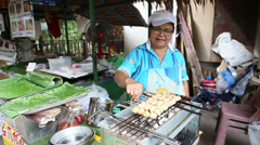 Asian Lady Cooking Grilled Pork Balls In Thailand Stock Footage