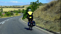 Hd:road traveler downhill cycling - stock video Stock Footage