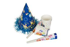 Disposable cups with party horn blowers and a party hat Stock Photos