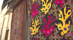 Athens, colourful rugs hanging at a shop Stock Footage