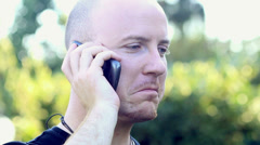 Appealing young casual man speaking on the phone - stock footage
