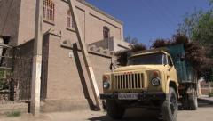Soviet truck drives through Uzbek town Stock Footage