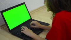 Girl using computer with green screen for web and e-mail - stock video Stock Footage