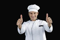 Portrait of a chef gesturing thumbs up sign Stock Photos