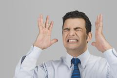 Close-up of an angry businessman - stock photo