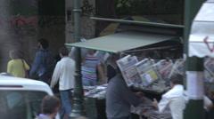 Drive plate, slow along busy sidewalk, gritty street, street vendors... Stock Footage