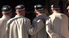 Senior Uzbek men, friends, classic muslim hats, hand on shoulder, friendship - stock footage