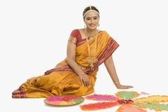 Stock Photo of South Indian woman making rangoli