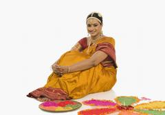 South Indian woman making rangoli - stock photo