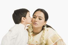 Boy kissing his mother Stock Photos