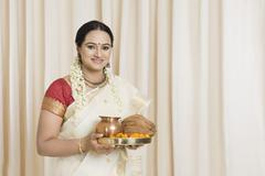 Stock Photo of South Indian woman holding pooja thali