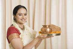 South Indian woman holding pooja thali - stock photo