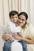 Stock Photo of Woman loving with her son at home