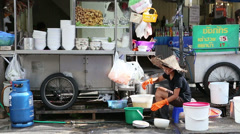 Street Vendor Lady Washes Her Dirty Dishes Stock Footage