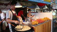 Vendors Frying Pork Balls at a Bangkok Market Stock Footage