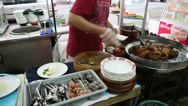 Stock Video Footage of Vendor Slicing and Serving Stewed Pok Leg in Bangkok