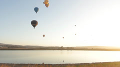 Colorful hot air balloon Festival in Israel mountain landscape Stock Footage