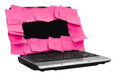 Adhesive notes attached on a laptop screen - stock photo