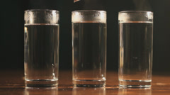 Teabag in several glasses of hot water, Closeup Stock Footage