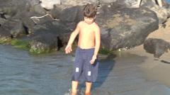 Boy play on sea beach. Stock Footage