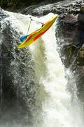 Stock Photo of Kayak Suspended On A Zip Line Extreme Sport Theme