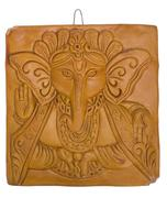 Stock Photo of Lord Ganesha engraved on a wooden block