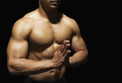 Close-up of a muscular man meditating Stock Photos